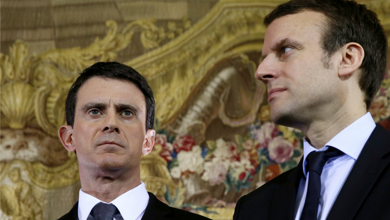 (FILES) This file photo taken on February 8, 2016 shows French Prime Minister Manuel Valls (L) and French Economy and Industry minister Emmanuel Macron during a press conference after a meeting with the leaders of the retail sector amid a crisis in France's agricultural sector in Paris.
