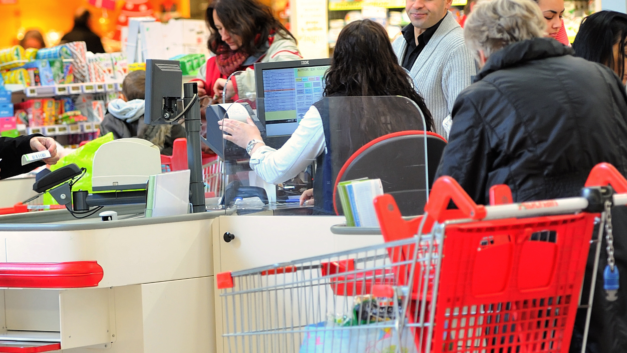 People do their shopping at an Auchan supermarket in Faches-Thumesnil on December 6, 2012. AFP PHOTO PHILIPPE HUGUEN PHILIPPE HUGUEN / AFP