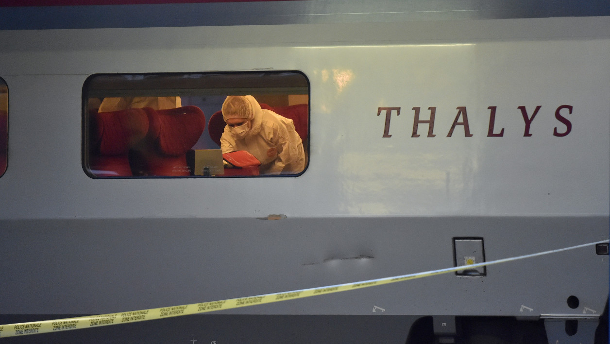 "(FILES) This file photo taken on August 21, 2015 shows police inspecting the crime scene inside a Thalys train of French national railway operator SNCF at the main train station in Arras, northern France. Belgian police on June 20, 2016 detained six people in connection with a foiled attack last year on a train travelling from Amsterdam to Paris through Brussels, prosecutors said. ""Six people were detained and taken to a court hearing,"" the federal prosecutor's office said, adding that no weapons or explosives were found in six raids. 