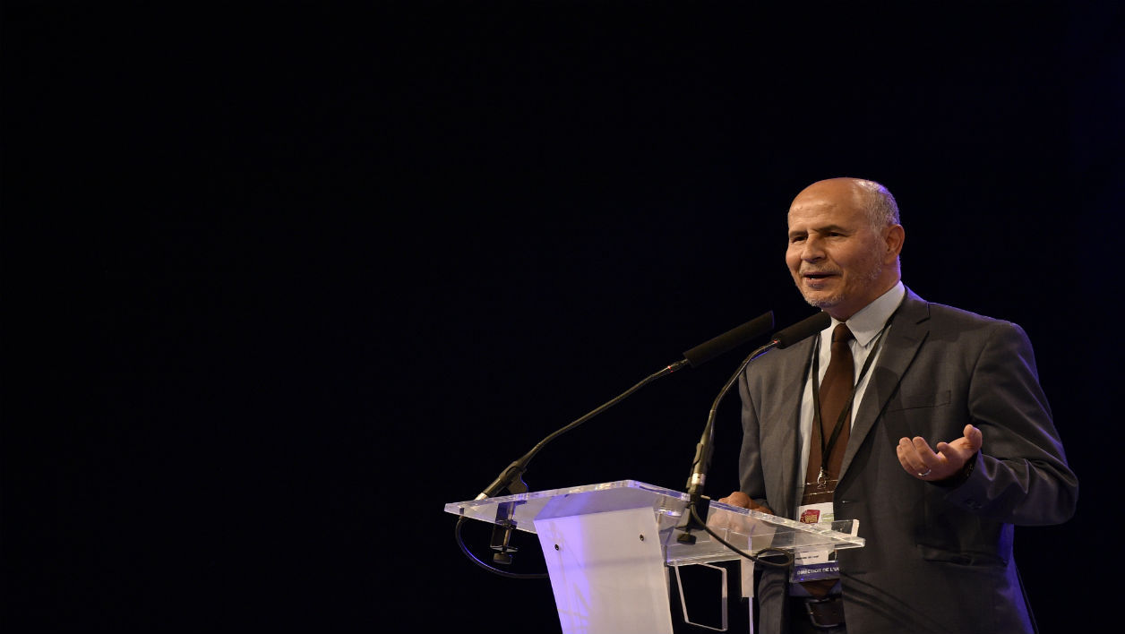 President of the Union of Islamic Organisations of France (UOIF) Amar Lasfar delivers a speech at the 33rd annual meeting of French muslims organised by the UOIF, on May 13, 2016 in Le Bourget, northeast of Paris. MARTIN BUREAU / AFP