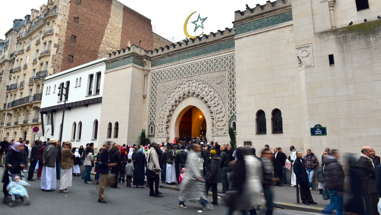 "Muslims arrive at the Grande Mosque of Paris on the first day of Eid al-Adha on October 26, 2012 in Paris. Eid al-Adha, or ""Feast of sacrifice"" is celebrated throughout the Muslim world as a commemoration of Abraham's willingness to sacrifice his son for God, with cows, camels, goats and sheep are traditionally slaughtered on the holiest day. AFP PHOTO MIGUEL MEDINA MIGUEL MEDINA / AFP"