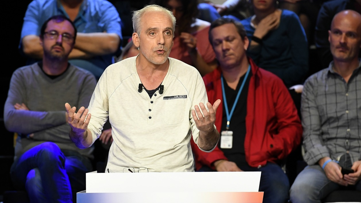 French presidential election candidate for the far-left New Anticapitalist Party (NPA) Philippe Poutou speaks during a debate organised by the French private TV channels BFM TV and CNews, between the eleven candidates for the French presidential election, on April 4, 2017 in La Plaine-Saint-Denis.  Lionel BONAVENTURE / POOL / AFP