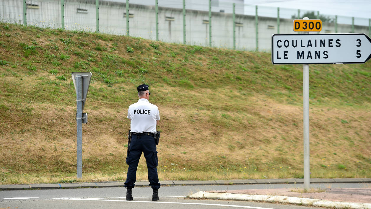 AFP Photo RÉFÉRENCE DOCUMENT000_DT8WM SLUGFRANCE - PRISON - HOSTAGE DATE DE CRÉATION04/08/2016 PAYSFRANCE CRÉDITJEAN-FRANCOIS MONIER / AFP POIDS FICHIER/PIXELS/DPI46.25 Mb / 4928 x 3280 / 300 dpi FRANCE-PRISON-HOSTAGE  A police officer stands outside the prison of Le Mans Les Croisettes in Coulaines, on August 4, 2016, where two people including a prison warden and an inmate are held hostage by another inmate, according to police