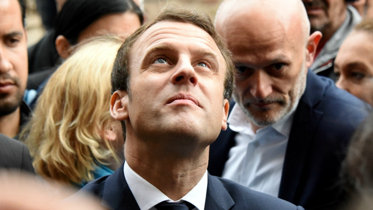 French presidential election candidate for the En Marche ! movement, Emmanuel Macron looks on during a visit at the Compagnons du Devoir house in Rodez, southern France on May 5, 2017.  José A. Torres / AFP