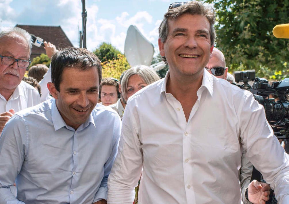FRANCE, Frangy-en-Bresse : French Economy Minister Arnaud Montebourg gestures while delivering a speech, on August 24, 2014 in Frangy-en-Bresse, eastern France, during the 42nd Fete de la Rose (Rose Celebration), a traditionally socialist event organized few days ahead of the Socialist Party (PS) summer conference. AFP PHOTO / JEFF PACHOUD