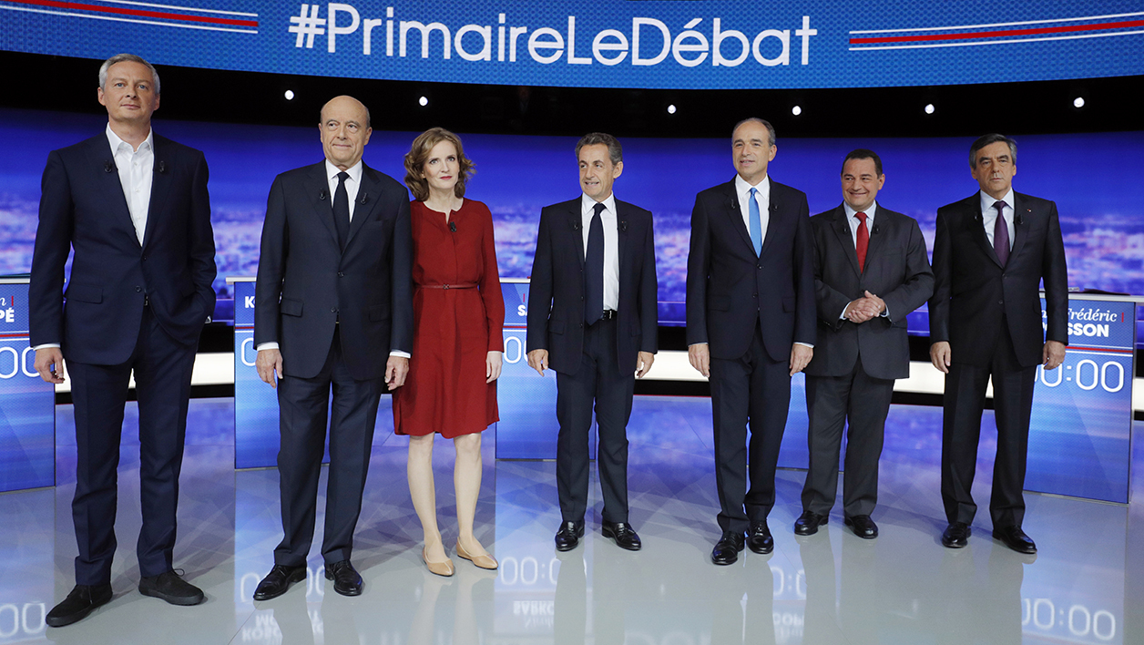 Candidates for the right-wing Les Republicains (LR) party primaries ahead of the 2017 presidential election, (LtoR) former French Agriculture minister Bruno Le Maire, former prime minister and current Bordeaux mayor Alain Juppe, French lawmaker Nathalie Kosciusko-Morizet, former French President Nicolas Sarkozy, French lawmaker Jean-Francois Cope, head of the French Christian democratic party Jean-Frederic Poisson and former prime minister and French lawmaker Francois Fillon pose before the first televised debate between the seven candidates for France's right-wing presidential nomination, on October 13, 2016 at the studios of French private television channel TF1 in La Plaine-Saint-Denis, north of Paris. The debate is the first of three ahead of a primary widely seen as the main battle for the presidency, with unemployment, terrorism and immigration uppermost in the minds of voters, according to recent polls.