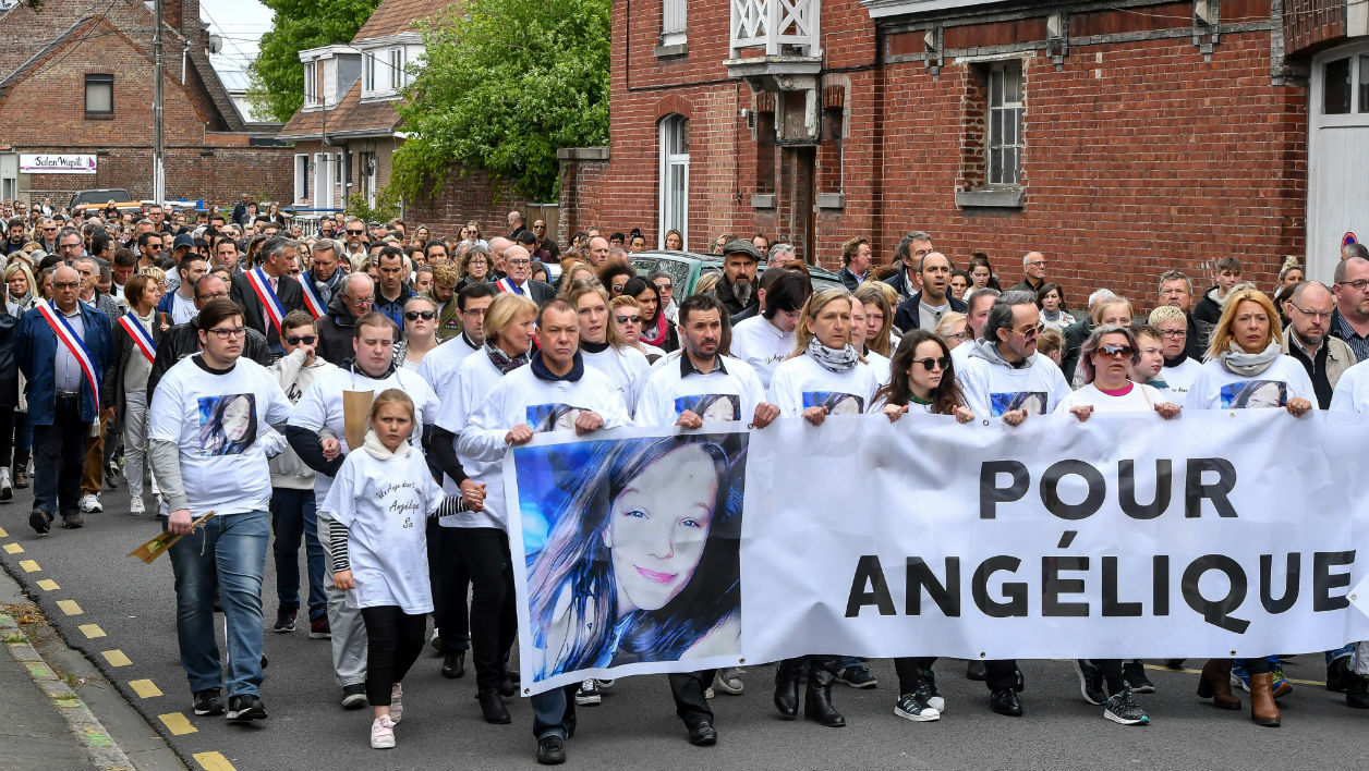 Hundreds of people take part in a march in Wambrechies, northern France, on May 1, 2018, in tribute to Angelique, a 13-year-old girl who was killed and raped on April 25.