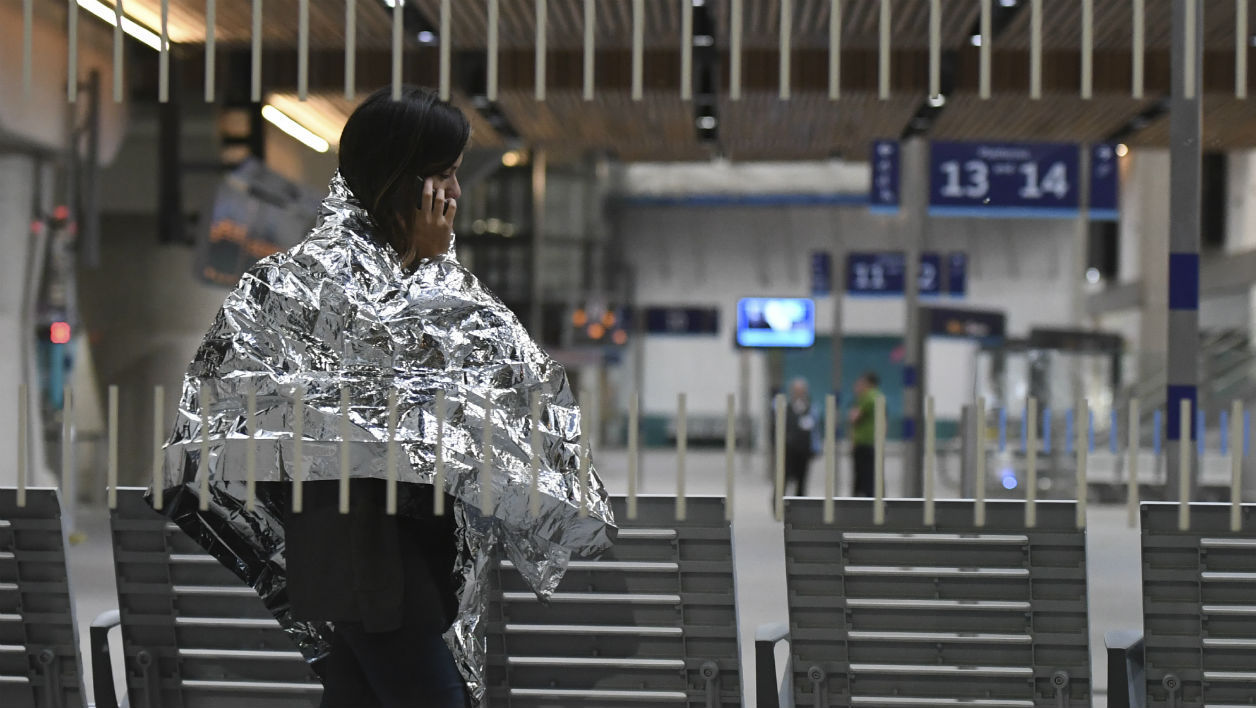 "A woman wearing an emergency blanket talks on her phone at London Bridge train station on June 3, 2017 following a terror attack. Armed police opened fire during what they described as a ""terrorist"" attack in central London Saturday after reports of stabbings and a van ploughing into pedestrians just days ahead of a general election. Chris J Ratcliffe / AFP"
