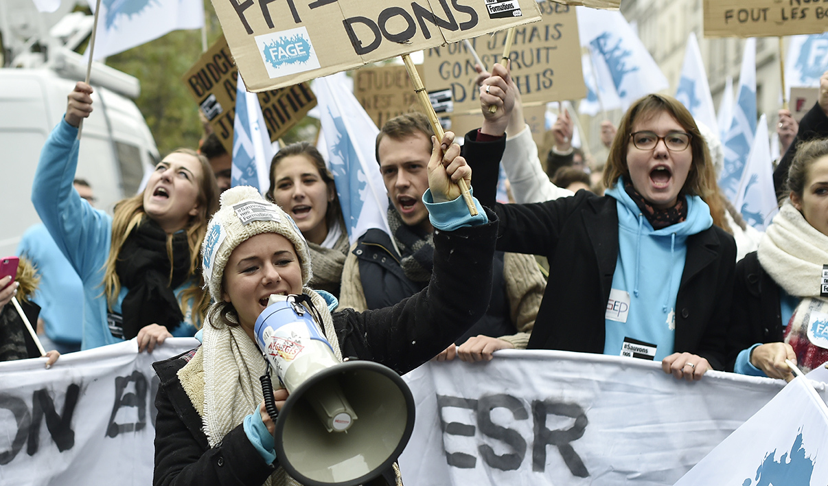 French students and teachers take part in a demonstration organised by Unef and UNL unions to protest against precarity and austerity on October 16, 2015 in Paris