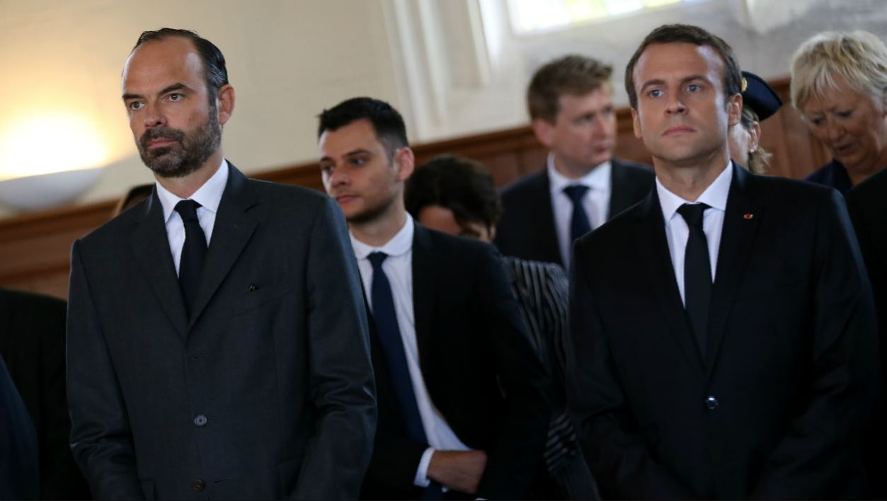 French Prime Minister Edouard Philippe (L) and French President Emmanuel Macron attend a mass marking the first anniversary of the killing of French Catholic priest Jacques Hamel by two jihadists at his church in Saint-Etienne-du-Rouvray on July 26, 2017.  CHARLY TRIBALLEAU / POOL / AFP