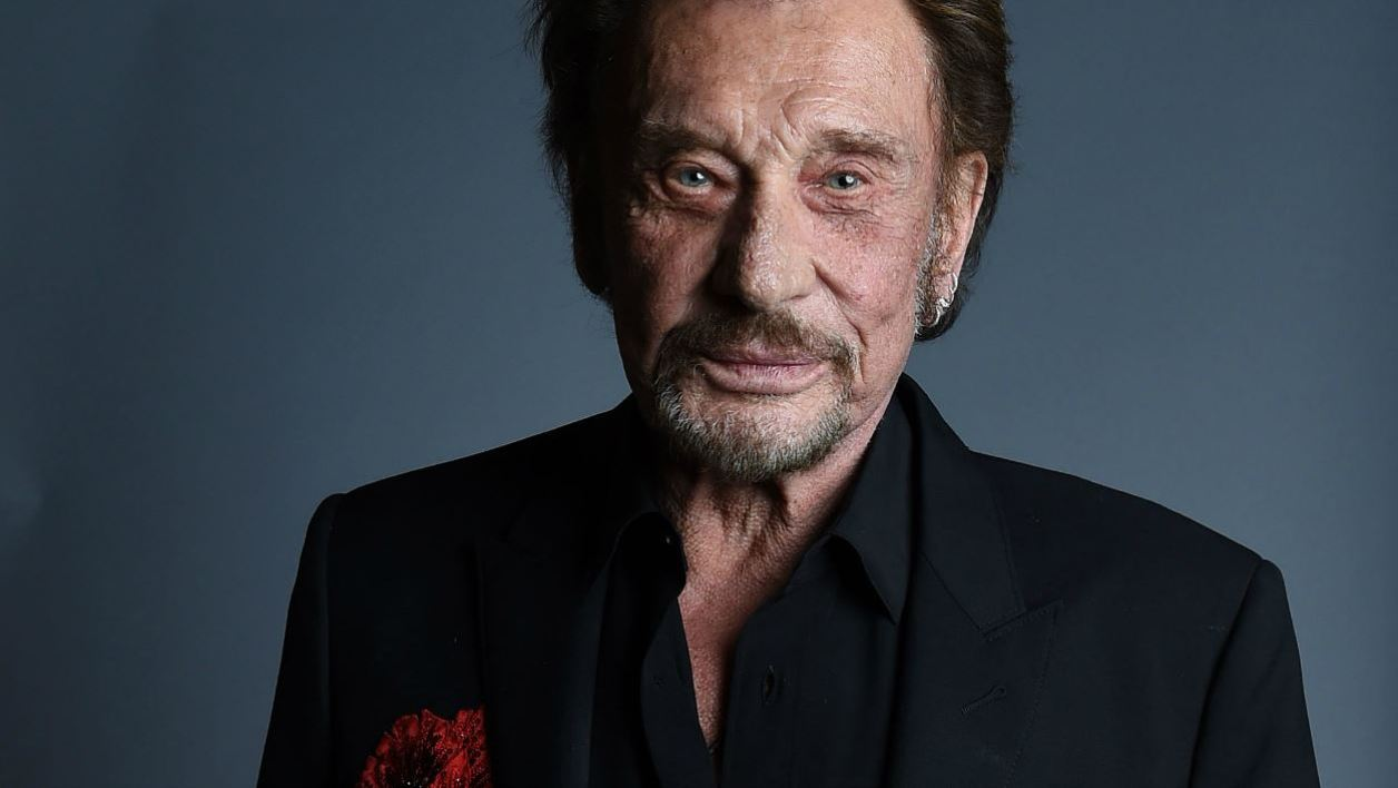 """This file photo taken on April 19, 2016 shows Singer Johnny Hallyday attending the 20th annual COLCOA French Film Festival Opening Night at the Directors Guild of America in West Hollywood, California. Johnny Hallyday """"is at home and rest,"""" Sebastian Farran, the manager of the 74-year-old star, told AFP on November 30, 2017, denying rumours about his death that appeared on social networks. VALERIE MACON / AFP"""