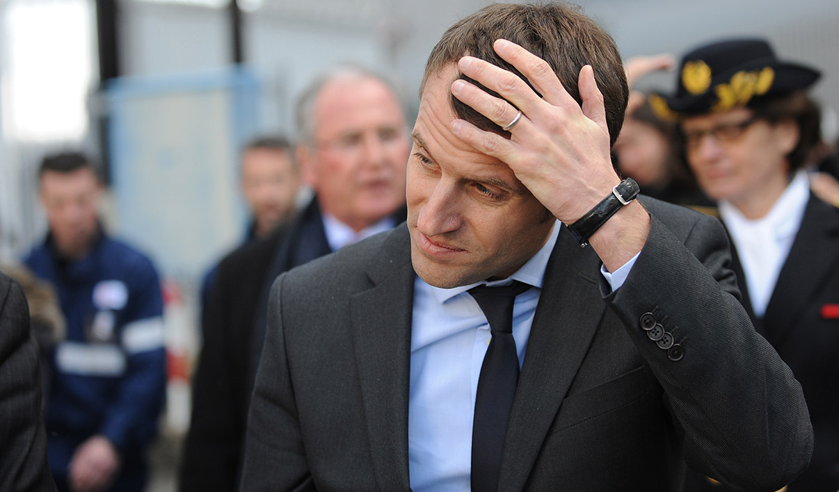 "French Economy Minister Emmanuel Macron looks on at the site of the nuclear power plant in Civaux, in western France, on March 17, 2016. The French government stands ready to inject fresh capital into energy giant EDF if necessary, Economy Minister Emmanuel Macron said on Thursday. ""If there is a need to recapitalise, we will do so"" Macron said during a visit at the Civaux nuclear station in central France."