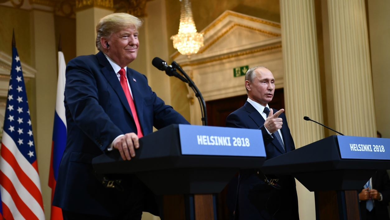 US President Donald Trump and Russia's President Vladimir Putin attend a joint press conference after a meeting at the Presidential Palace in Helsinki, on July 16, 2018.  Brendan Smialowski / AFP