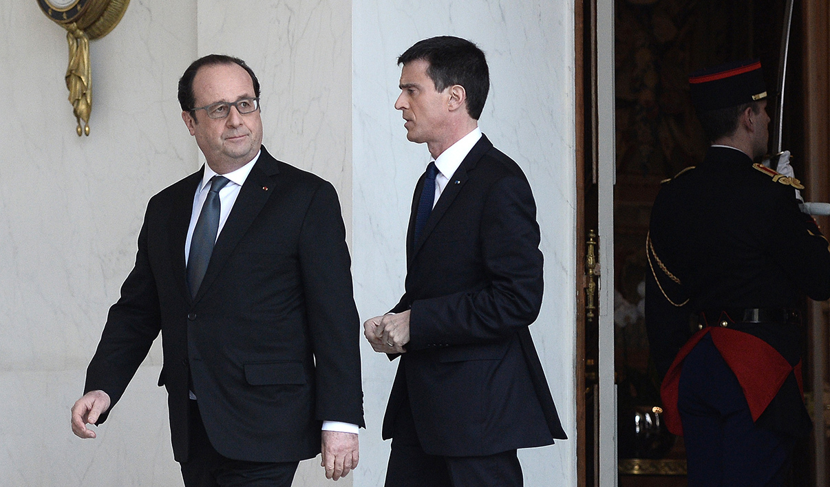 French President Francois Hollande (L) and Prime minister Manuel Valls leave after the weekly cabinet meeting on February 17, 2016 at the Elysee presidential palace in Paris. This was the first cabinet meeting after the government was reshuffled the week before
