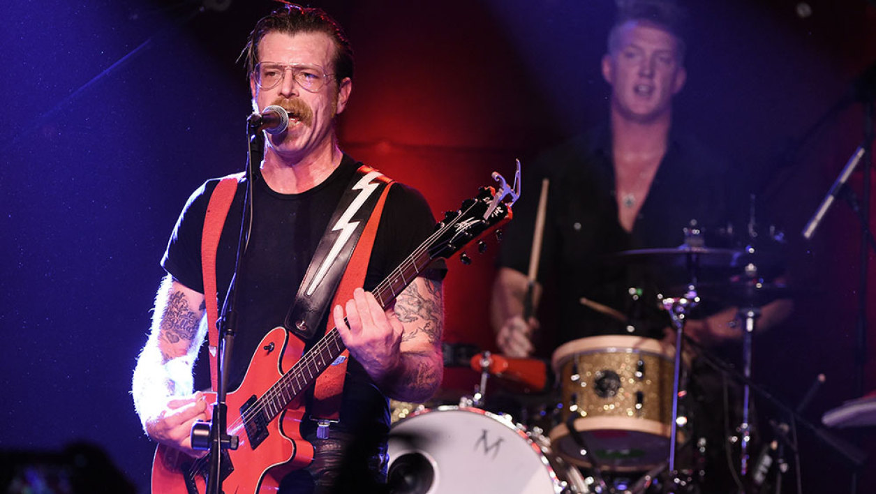 "A file picture taken on October 19, 2015, Musicians Jesse Hughes (L) and Josh Homme of Eagles of Death Metal perform at the Teragram Ballroom on in Los Angeles, California. Hugues, the Eagles of Death Metal singer who was performing at that Bataclan theater in Paris when gunmen attacked November 13, said many spectators died attempting to protect their friends. ""A great reason why so many were killed is because so many people wouldn't leave their friends. So many people put themselves in front of people,"" he said in an excerpted interview with Vice.com. Several people tried to escape by hiding in the band's dressing room, to little avail, he said."