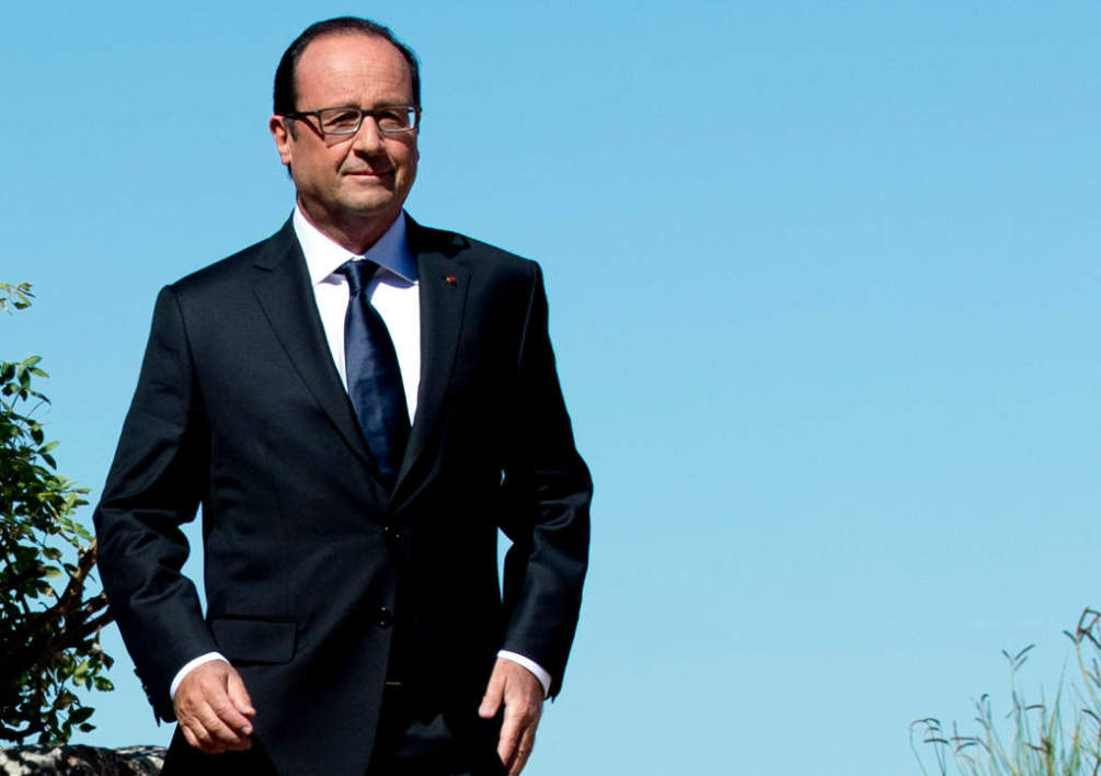 FRANCE, Toulon : French President Francois Hollande arrives to deliver a speech during ceremonies marking the 70th anniversary of the Allied landing in Provence, on August 15, 2014 at the Mont Faron memorial, in Toulon, southern France. Two months after D-Day, the Allied invasion of southern France pushed the exhausted Nazi army back towards Germany and hastened the end of World War II in Europe. AFP PHOTO / ALAIN JOCARD