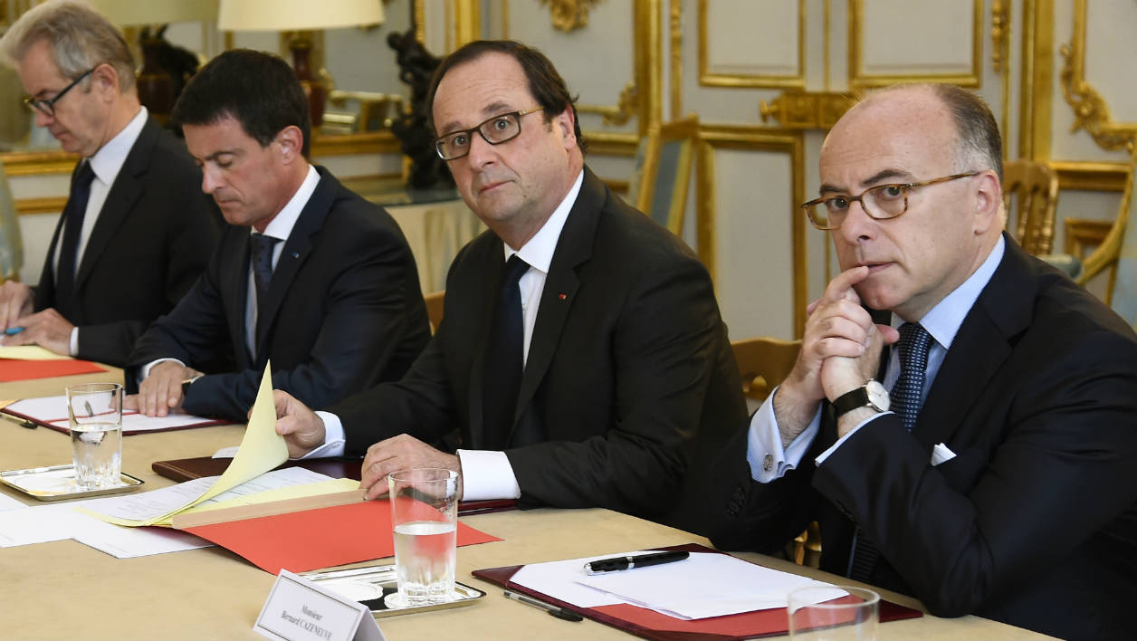 """French President Francois Hollande (2nd R), flanked by French Interior Minister Bernard Cazeneuve (R) and French Prime Minister Manuel Valls (3rd R), looks on during a meeting with French representatives of the different religions at the Elysee Presidential Palace in Paris on July 27, 2016 following yesterday attack at a church in Saint-Etienne-Du-Rouveray. France probes an attack on a church in which two men described by the Islamic State group as its """"soldiers"""" slit the throat of a priest. An elderly priest had his throat slit in a church in northern France on July 26 after two men stormed the building and took hostages. The attack in the Normandy town of Saint-Etienne-du-Rouvray came as France was still coming to terms with the Bastille Day killings in Nice claimed by the Islamic State group."""