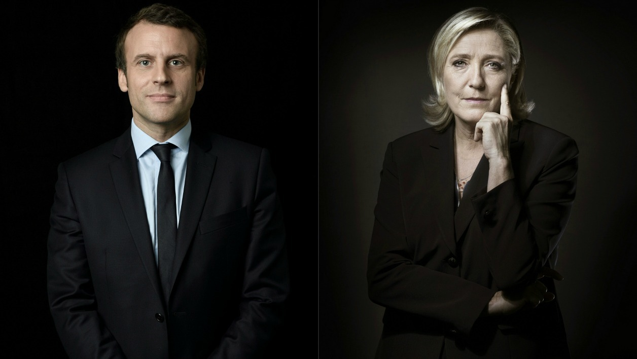 A combination of pictures made on April 23, 2017 shows French presidential election candidate for the En Marche ! movement Emmanuel Macron (L) and French presidential election candidate for the far-right Front National (FN) party Marine Le Pen posing in Paris.  Eric Feferberg, Joël SAGET / AFP