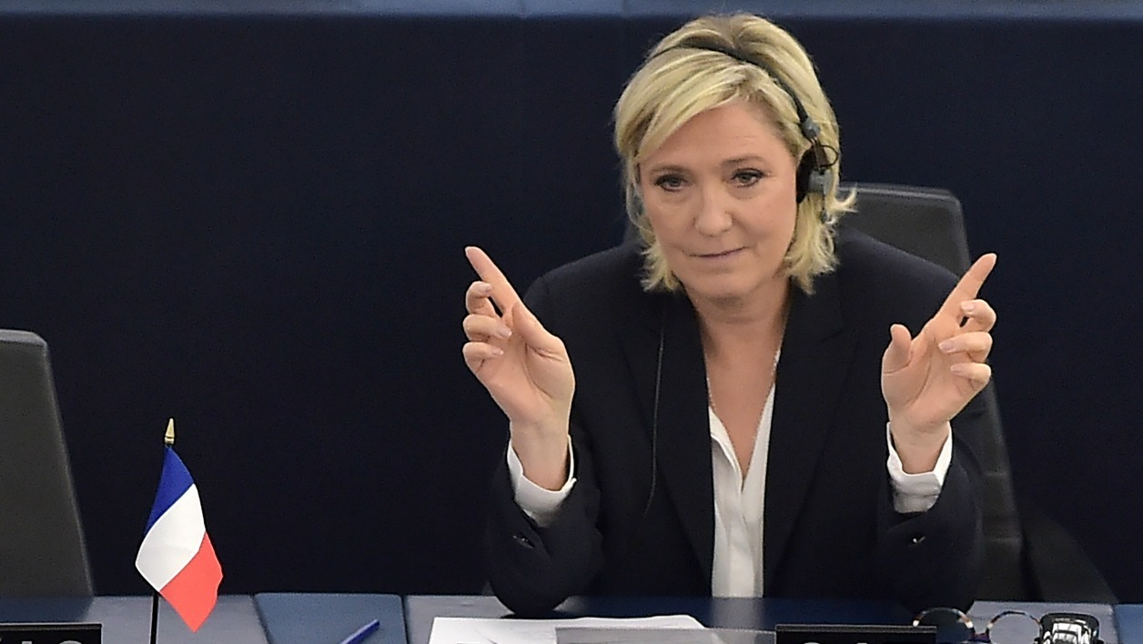 French far-right party Front National (FN) President and member of the European Parliament, Marine Le Pen, gestures during a debate on the consequences of the Brexit on July 5, 2016 at the European Parliament in Strasbourg, eastern France.  PATRICK HERTZOG / AFP