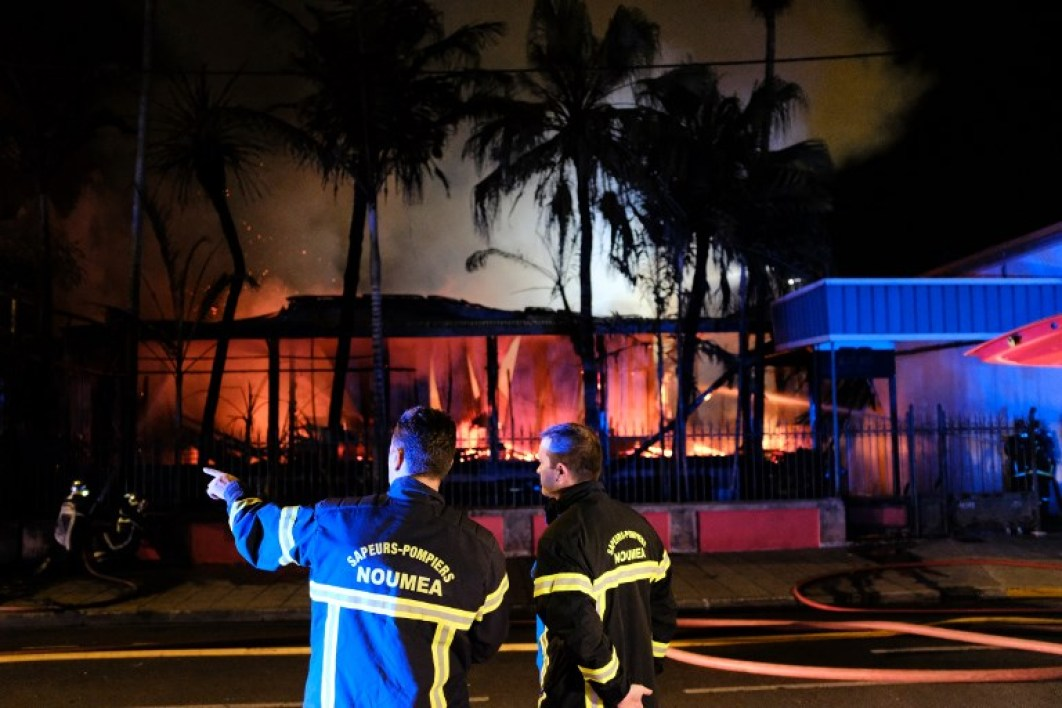 Firefighters try to extinguish a house set on fire in downtown Noumea overnight on Novembre 5, 2018, after the results from an independence referendum in the French Pacific territory of New Caledonia. Partial results from an independence referendum in the French Pacific territory of New Caledonia showed that a large majority of voters had opted to remain part of France, local media reported on November 4. With 70 percent of voting slips counted, 59.5 percent of people had rejected the proposition that New Caledonia become independent, television channel Nouvelle-Caledonie la 1ere reported.  Theo Rouby / AFP