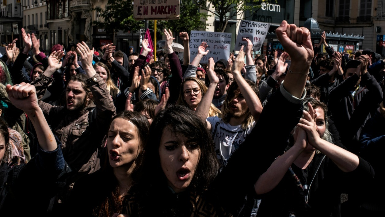 rotesters shout slogans during the annual May Day workers' rally in Lyon, east-central France, on May 1, 2017.  JEFF PACHOUD / AFP