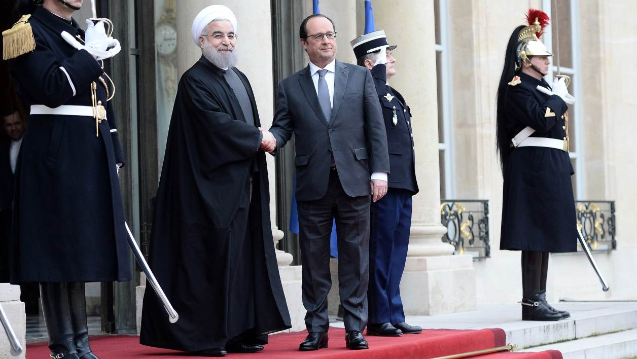"French President Francois Hollande (R) shakes hands with Iranian President Hassan Rouhani upon his arrival on January 28, 2016 at the Elysee Presidential Palace in Paris. President Hassan Rouhani hailed a ""new relationship"" between Iran and France during a visit that saw the signing of a host of post-sanctions business deals."