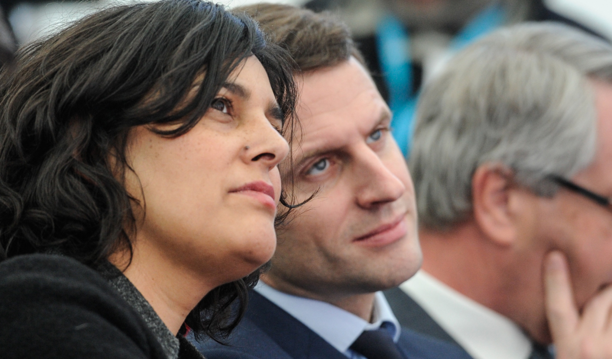 French Labour minister Myriam El Khomri (C) and French Economy Minister Emmanuel Macron (2R) listen to a speech during a visit at Solvay's (International chemical group) factory on February 22, 2016, in Chalampe, eastern France.