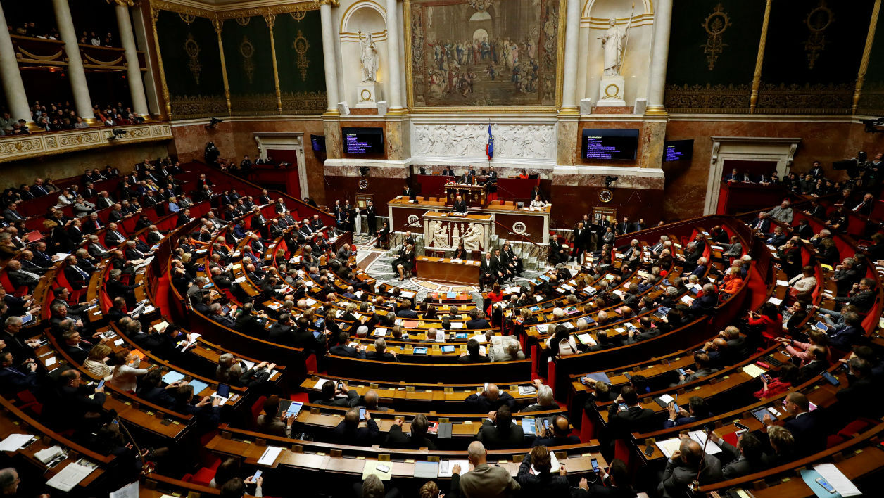 This file photo taken on December 13, 2016 shows French Prime Minister Bernard Cazeneuve (C) delivering his first policy speech at the National Assembly in Paris. The second round of the French legislative elections will take place on June 18, 2017.  Patrick KOVARIK / AFP