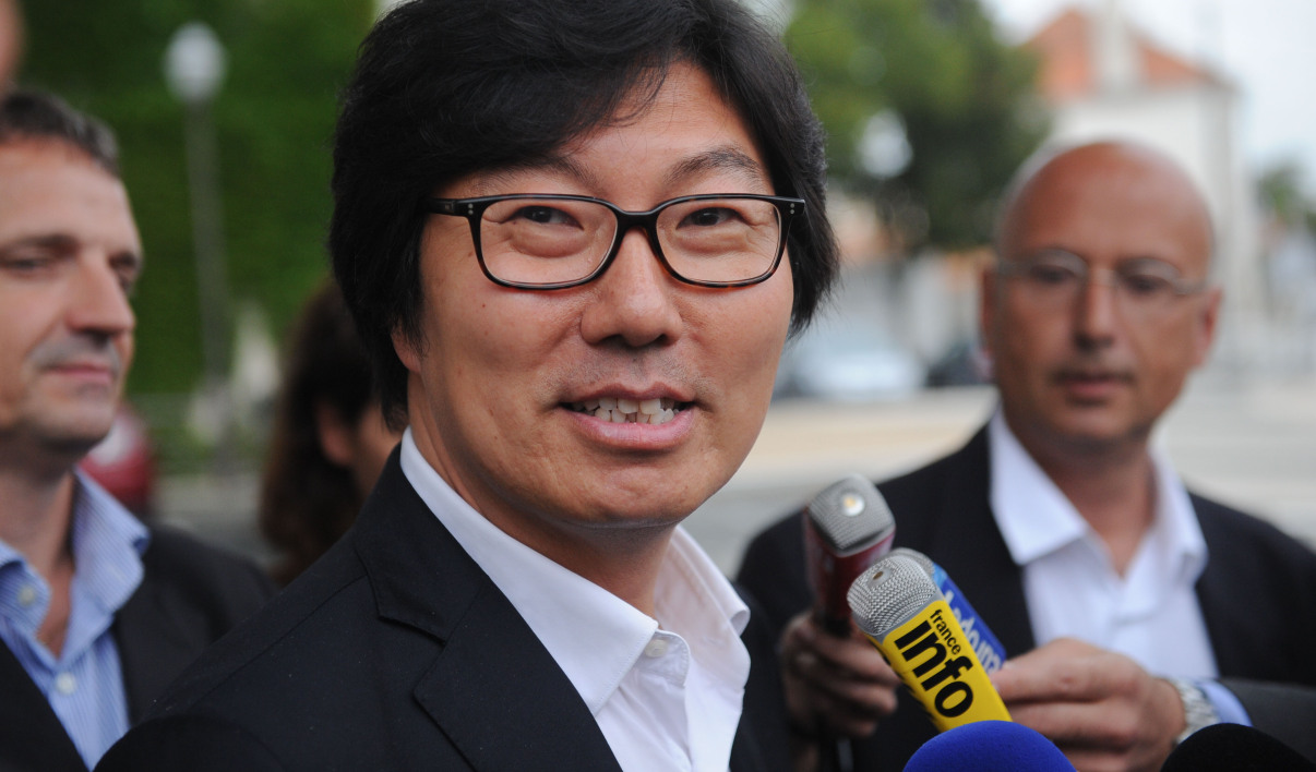 EELV senator Jean-Vincent Place answers journalists' questions as he arrives to take part in the first summer congress of the Front Democrate at the coastal city of La Rochelle, southwest France on August 27, 2015
