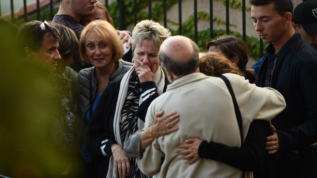 Relatives of the victim Mauranne take part in a tribute, on October 2, 2017, in Eguilles, southern France, the day after Mauranne and Laura, two 20-year-old cousins, were killed outside Saint-Charles train station in Marseille by an Islamist knifeman who was shot dead by soldiers.