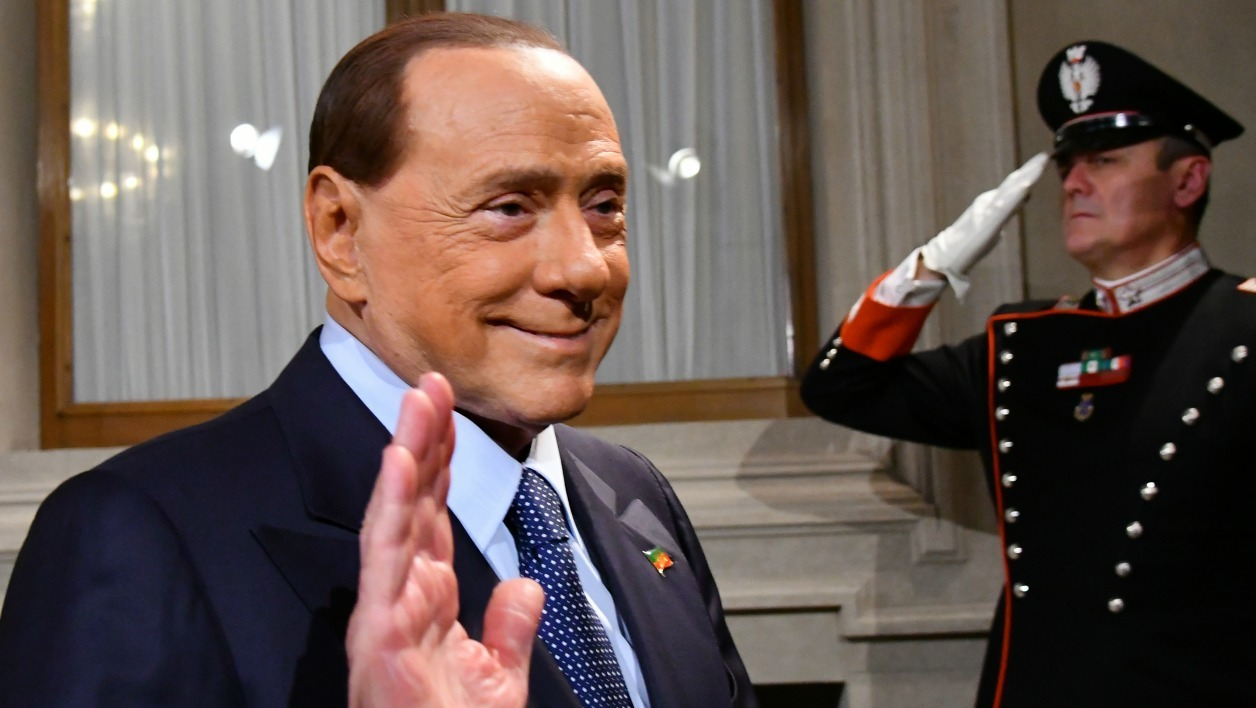The leader of centre-right party Forza Italia - Il Popolo della Liberta, Silvio Berlusconi leaves after a press point following a meeting with Italy's President Sergio Mattarella on December 10, 2016 at the Quirinale Palace in Rome. Representatives of Italy's main parties are headed to the presidential palace, their task to agree on a new government made even more urgent by fears of a banking crisis in the eurozone's third-largest economy.