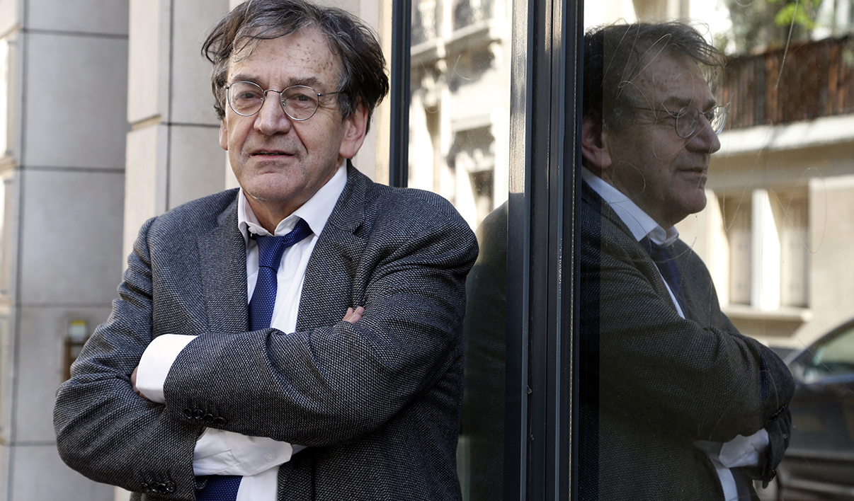 French philisopher Alain Finkielkraut reacts at his publisher's headquarters Stock on April 10, 2014 in Paris. Alain Finkielkraut was elected to the Academie Francaise (French Academy) chair of Felicien Marceau, despite the controversy that preceded the vote. Finkielkraut was elected in the first round, with 16 votes out of 28.