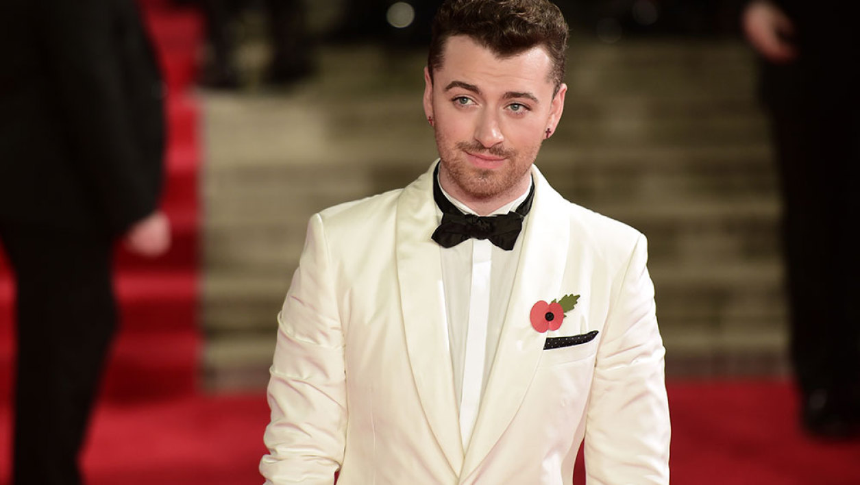 British singer Sam Smith poses on arrival for the world premiere of the new James Bond film 'Spectre' at the Royal Albert Hall in London on October 26, 2015. The film is directed by Sam Mendes and sees Daniel Craig play suave MI6 spy 007 for a fourth time.