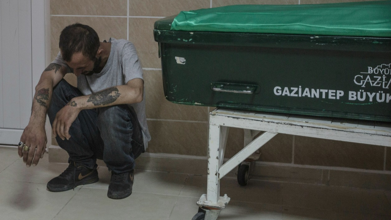 A man reacts next to the coffin of a victim from last night's attack on a wedding party that left 50 dead in Gaziantep in southeastern Turkey near the Syrian border on August 21, 2016. At least 50 people were killed when a suspected suicide bomber linked to Islamic State jihadists attacked a wedding thronged with guests, officials said on August 21.