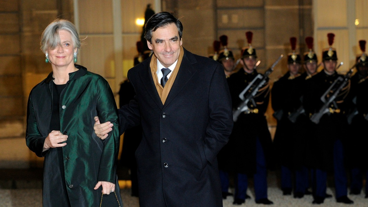 French Prime minister Francois Fillon and his wife Penelope arrive at the Elysee Palace to take part in an official dinner with French President Nicolas Sarkozy and his South African counterpart Jacob Zuma, on March 2, 2011 in Paris.