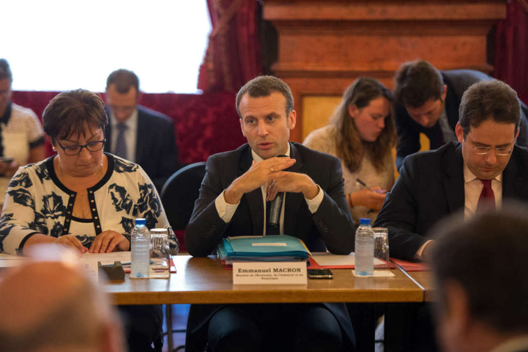 French Economy Minister Emmanuel Macron (C), flanked by French junior minister for Trade, Handicraft and Social and Solidarity Economy Martine Pinville (L) and French junior minister for Foreign Trade and Tourism Matthias Fekl (R), speaks during an economic meeting with President of the Provence Alpes Cote d'Azur region and regional representatives in Nice, southeastern France, on July 25, 2016.