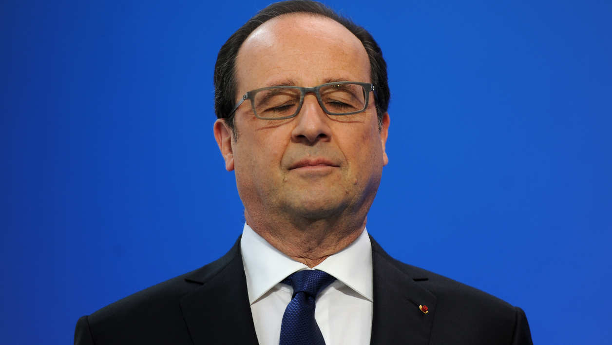 French President Francois Hollande blinks before delivering a speech during a visit to the insulin production plant of Danish multinational pharmaceutical company Novo Nordisk in Chartres, north-central France, on April 21, 2016.