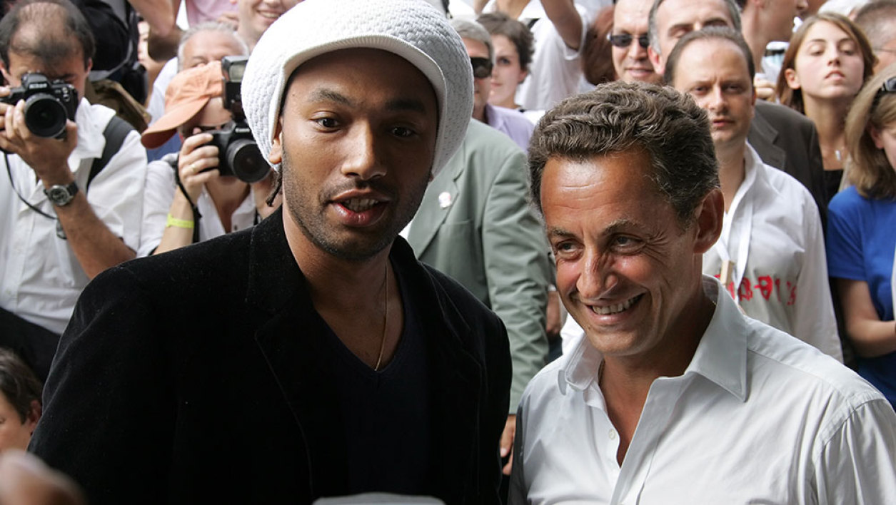 French rap singer Doc Gyneco (L) is photographed with Interior minister and president of right-wing party UMP Nicolas Sarkozy (R) during the UMP summer congress, 02 September 2006 in Marseille, southern France.