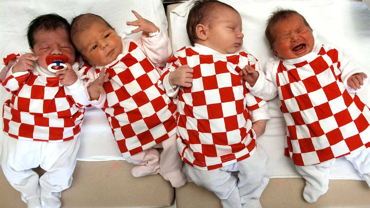 Newborn babies, in the maternity clinic of the northern Adriatic town of Rijeka lay dressed in their country's national football team colours of red and white checkerboard as World Cup football fever gripped Croatia, 16 June 2006. In their opening World Cup clash against Brazil 13 June, Croatia narrowly lost 0-1 against the world champions. AFP PHOTO STRINGER