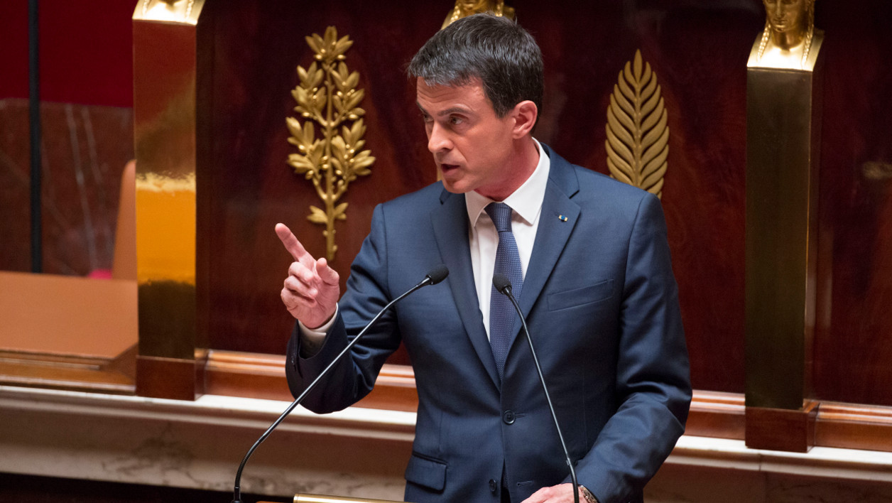 French Prime minister Manuel Valls gives a speech during a debate following by a no-confidence vote, on May 12, 2016 at the National Assembly in Paris. France's embattled Socialist government faces a no-confidence vote on May 12 after bypassing parliament to force through a labour reform bill that has drawn hundreds of thousands onto the streets over the last two months. The proposed labour reform, which would make it easier for employers to hire and fire workers, has sparked waves of sometimes violent protests across France since early March. Hollande's cabinet decided at an extraordinary meeting on May 10, 2016 to invoke the constitution's controversial Article 49.3.  GEOFFROY VAN DER HASSELT / AFP