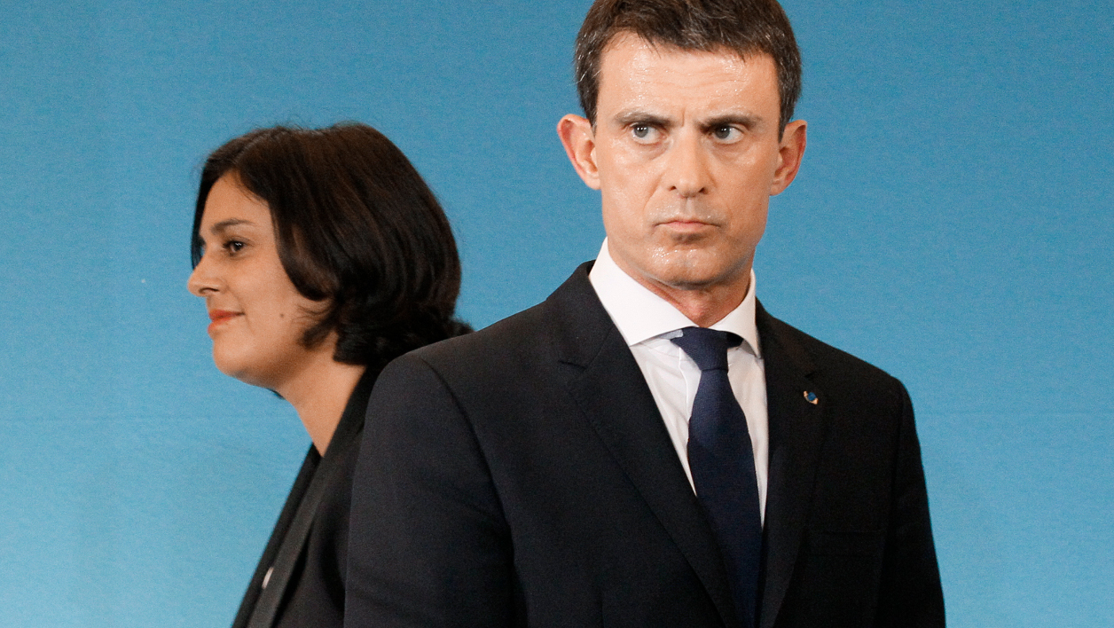 French Prime Minister Manuel Valls (R) attends a speech with Labour Minister Myriam El Khomri (L) to share Government orientations on Labour Code reform at the Hotel Matignon in Paris on November 4, 2015