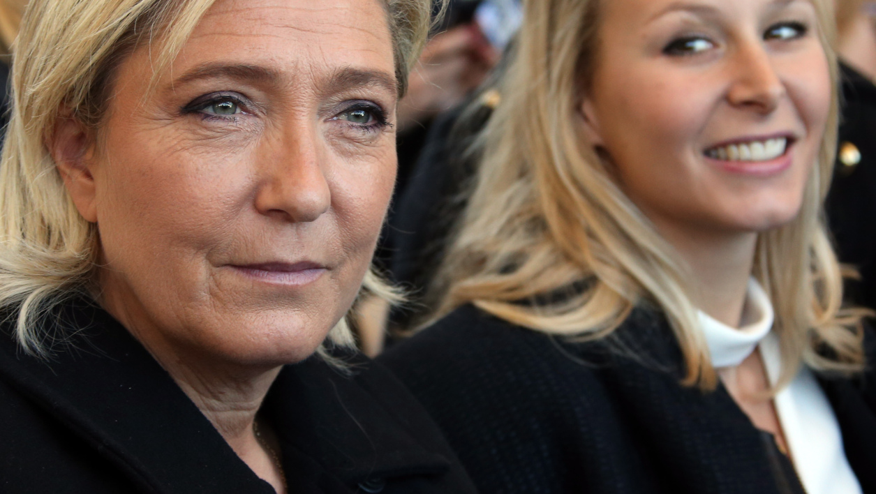 French far-right National Front party's leader Marine Le Pen (L) and FN Parliament member Marion Marechal-Le Pen attend on October 15, 2016 in Nice, southeastern France a national tribute to the victims of the July 14 terror attack in which a truck ploughed into crowds celebrating Bastille Day, killing 86 people and injuring more than 400. In the attack, a 31-year-old Tunisian extremist rammed a 19-ton truck through a crowd of more than 30,000 Bastille Day revellers on the seafront Promenade des Anglais before police shot him dead. The Islamic State (IS) group said the driver of the truck, Mohamed Lahouaiej Bouhlel, was one of its followers.  ERIC GAILLARD / POOL / AFP