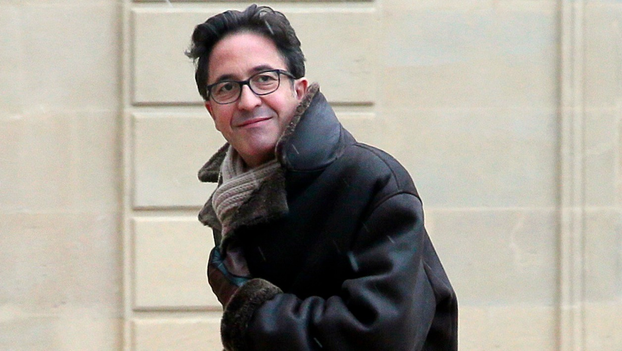 This file picture dated February 25, 2013 shows political advisor of France's President Francois Hollande, Aquilino Morelle, arriving at the Elysee presidential palace to attend a political meeting with ministers and French President Francois Hollande on public finances and social protection, in Paris. Aquilino Morelle announced his resignation on April 18, 2014 following revelations about an alleged conflict of interest and his extravagant lifestyle.