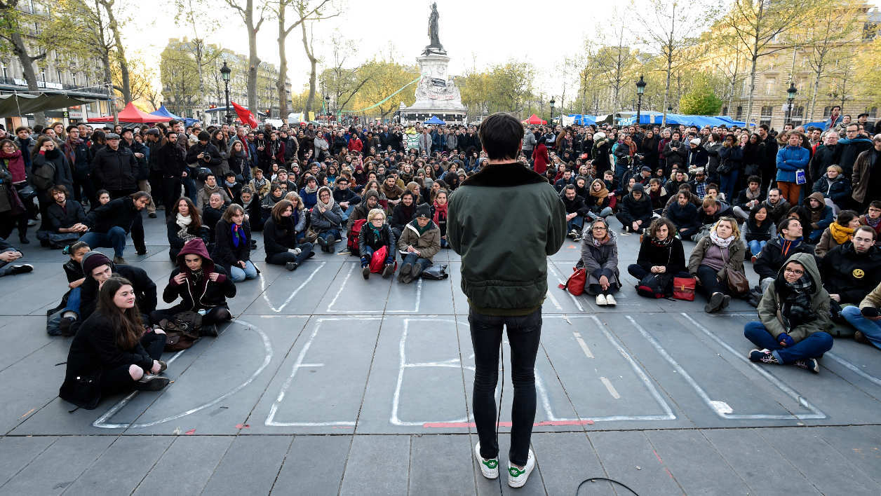 "People participate in a workshop during the ""Nuit Debout"" (Up All Night) movement against the French government's proposed labour reforms at the Place de la Republique in Paris on April 30, 2016.  MIGUEL MEDINA / AFP"