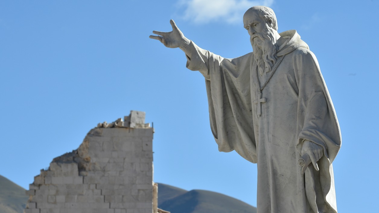 A picture shows a statue of St Benedict in the historic center of Norcia, a day after a 6.6 magnitude earthquake hit central Italy. It came four days after quakes of 5.5 and 6.1 magnitude hit the same area and nine weeks after nearly 300 people died in an August 24 quake that devastated the tourist town of Amatrice at the peak of the holiday season.