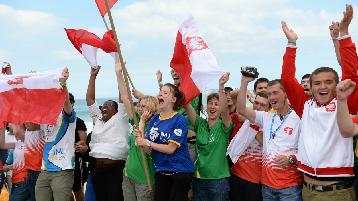 Catholics from Poland celebrate after the announcement that the next World Youth Day (WYD) will be held in Krakow, at the end of the final mass of Pope Francis' visit to Brazil, at Copacabana beach in Rio de Janeiro, on July 28, 2013.