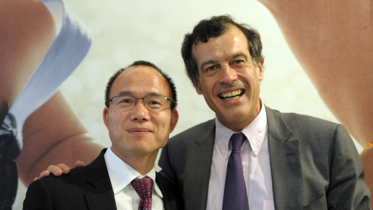 Le patron de Fosun Guo Guangchang et son homologue du Club Med Henri Giscard d'Estaing