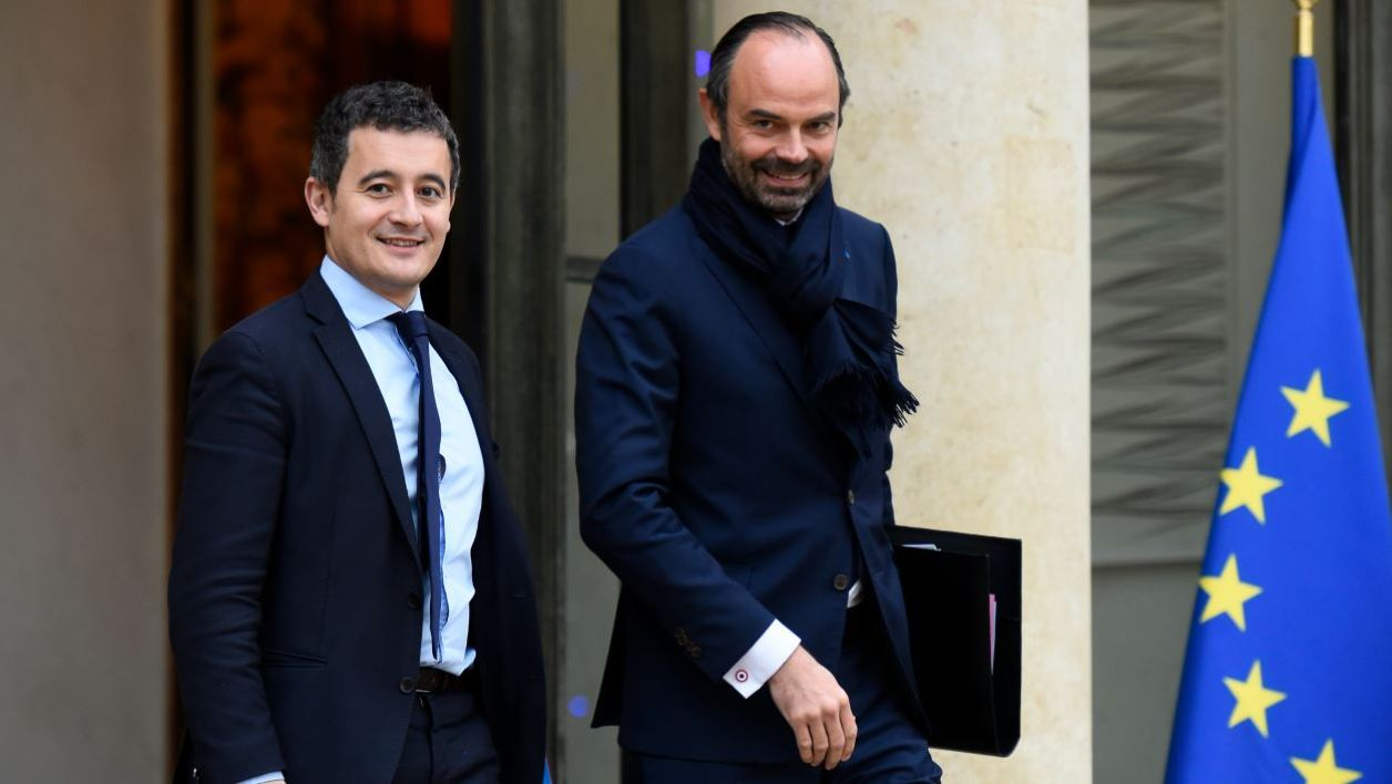 French Prime Minister Edouard Philippe (R) and French Minister of Public Action and Accounts Gérald Darmanin leave after a weekly cabinet meeting on December 13, 2017 at the Elysee palace in Paris.  Bertrand GUAY / AFP