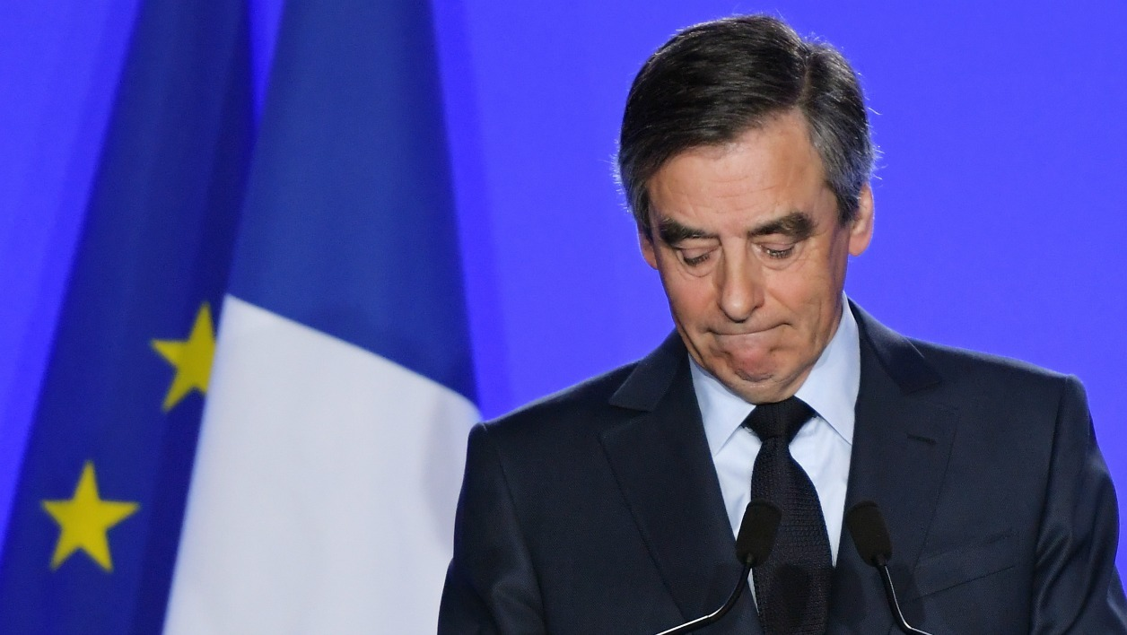 French presidential election candidate for the right-wing Les Republicains (LR) party Francois Fillon gives a press conference on March 1, 2017 in Paris. Fillon said he will be charged over allegations he paid his wife and children for fake jobs but that he would not pull out of the campaign.