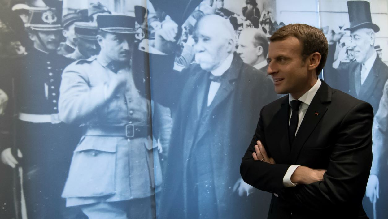 French President Emmanuel Macron passes a mural depicting former French Prime Minister during WWI, Georges Clemenceau, as he tours the Clemenceau museum in Paris, on November 11, 2017, during the Armistice Day commemorations marking the end of WWI.